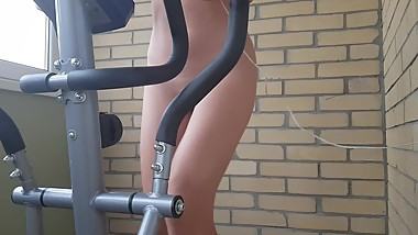 Naked girl on an exercise bike