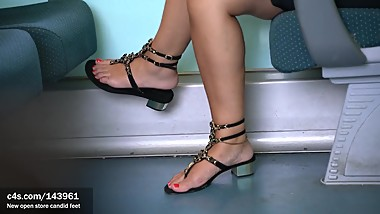 Candid sexy woman feet young student in flat sandals