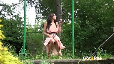 Naughty Girl Pisses While On The Swing