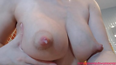 Mom showing her wet boobs full of milk